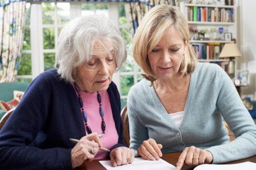 female neighbor helping senior woman